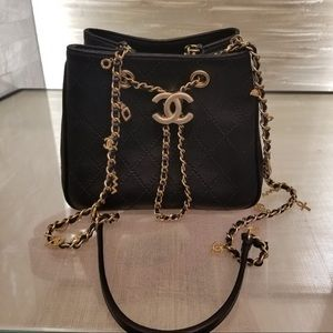 Chanel NWT bucket Bag with Long start & charms